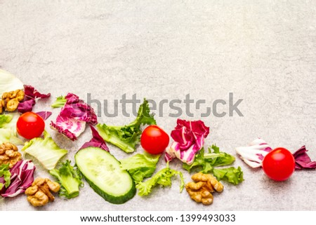 Vegan (vegetarian) healthy food concept ingredients. Fresh organic vegetables, walnuts and salad mix on stone cooking background, copy space #1399493033