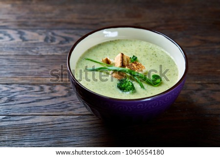 Vegaterian winter split pea turmeric soup on dark wooden background, close-up, top view #1040554180