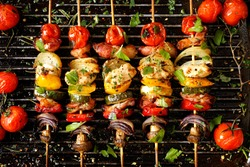 Vegetable and meat skewers in a herb marinade on a grill pan