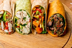 Vegetable beef and chicken wraps. Organic vegetable wraps filled with organic veggies.