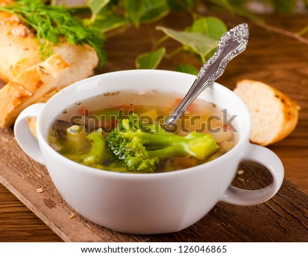 Vegetable broccoli soup and carrots, bread with fennel - stock photo