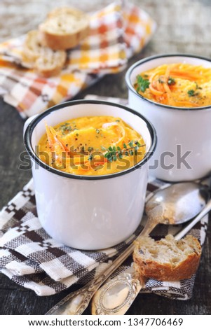 Vegetable carrot soup and bread, two portions. Rustic style