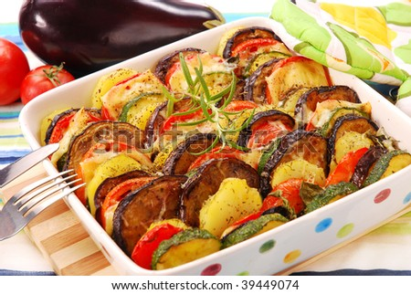 vegetable casserole with aubergine,zucchini,tomato,potato and cheese