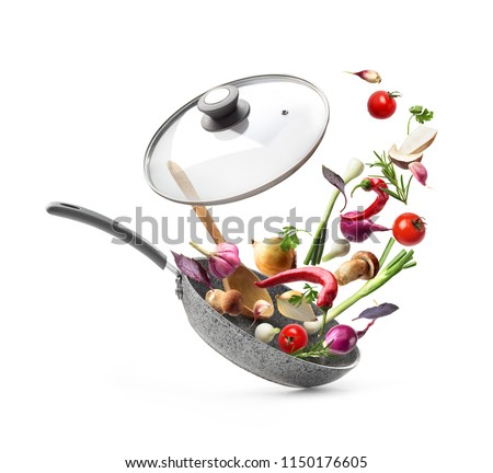 Vegetable composition. Frying pan with lid and flying vegetables, isolated on white background #1150176605