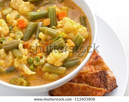 Vegetable curry soup with tortillas