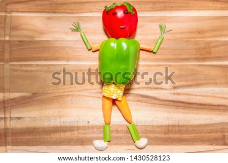 Vegetable dude made of peppers carrots and corn