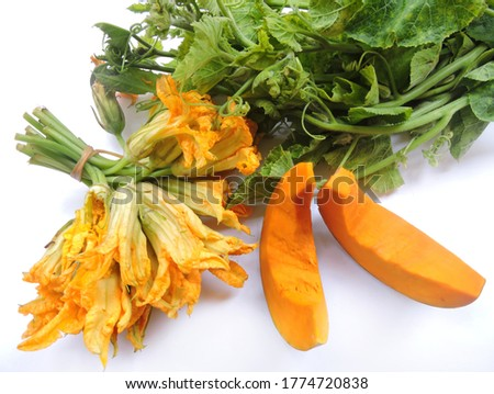Vegetable - Edible parts of pumpkin plant including fleshy shell, leaves and flowers. Scientific name - Cucurbita pepo.  Stock fotó ©