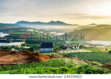 Photo of  Vegetable fields and Housein highland, Dalat, Vietnam. Da lat is one of the best tourism city in Vietnam. Dalat city is Vietnam's largest vegetable and flowers growing areas.