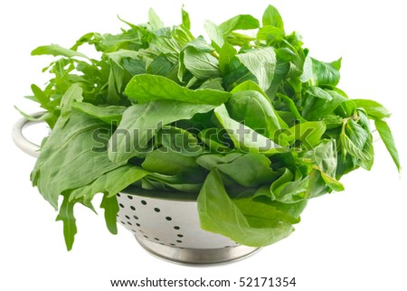 vegetable in colander isolated on white background