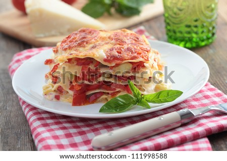 Vegetable lasagna with pepper, tomato, zucchini, parmesan cheese, and basil leaf