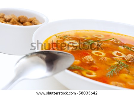 Vegetable lentil soup with olives and crackers.