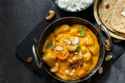 Vegetable or Navratan Korma - Indian Mixed Veg Curry served with Roti and rice Top down view