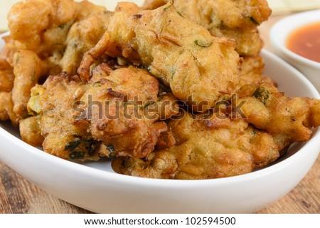 Vegetable Pakora or Onion Bhajis served with chili sauce. - stock photo