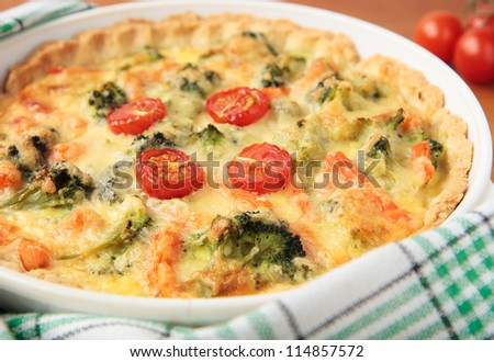 Vegetable pie with broccoli, carrots and tomatoes
