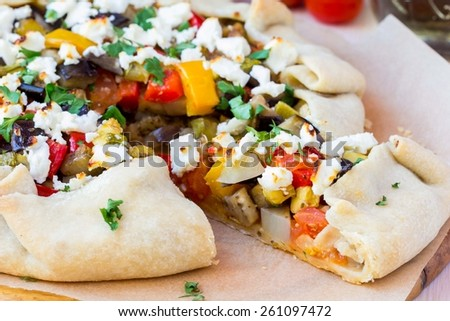 Vegetable pie with eggplant, zucchini, peppers, feta cheese, parsley, Greek dish