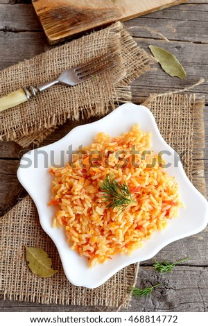 Vegetable Risotto On A Plate, Fork, Cutting Board On Old Wooden
