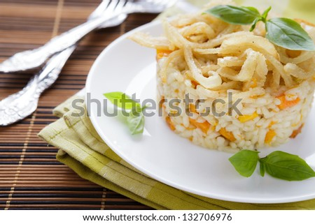 Vegetable risotto with onion and basil, closeup