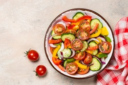 Vegetable salad from cucumber, tomato and paprika with olive oil. Vegetarian food.