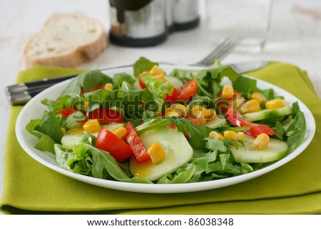 vegetable salad with bread and glass