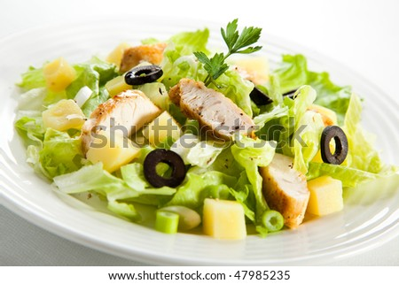 Vegetable salad with chicken meat and boiled potatoes