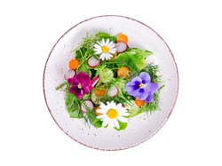 Vegetable salad with edible flowers on white background. Studio Photo