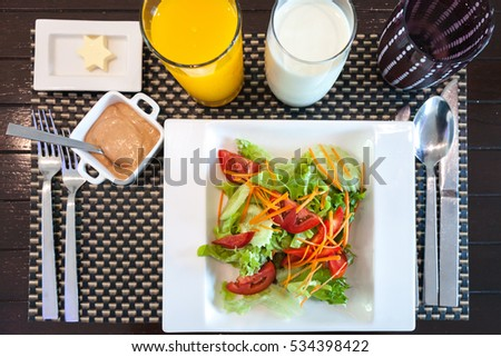 Vegetable salad with orange juice and milk for breakfast #534398422