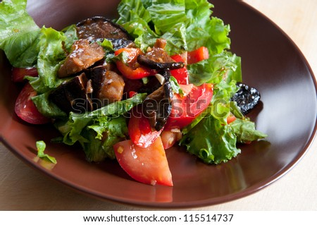 Vegetable salad with pieces of roasted pork and shiitake mushrooms, horizontal shot