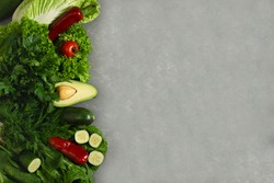Vegetable set with green and red products on a gray background with space for menus or diet records