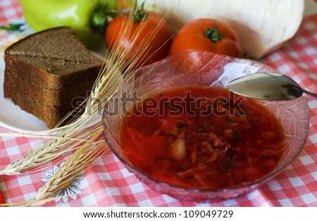 Vegetable soup in a bowl, bread and vegetables