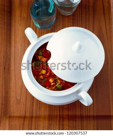 Vegetable soup in an opened tureen