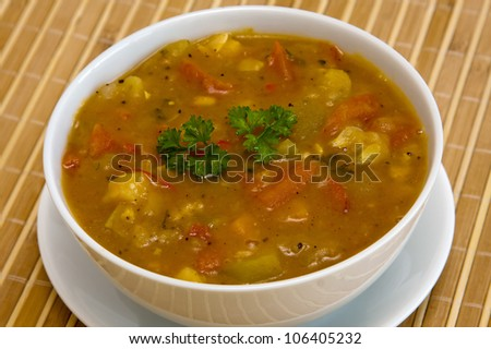 Vegetable soup on white plate