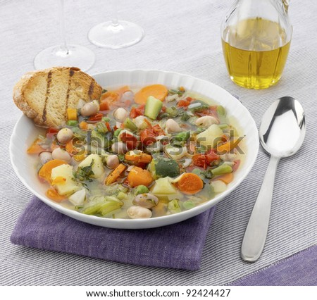 Vegetable soup with a slice of bread