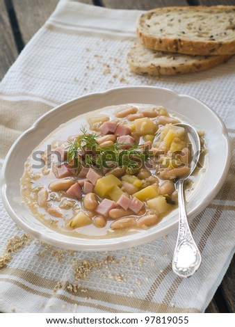 Vegetable soup with beans and ham, selective focus