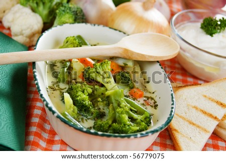 Vegetable soup with broccoli and carrot served with toasted bread
