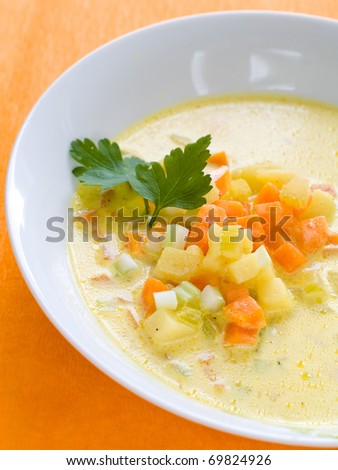 Vegetable soup with carrot, cabbage and potatoes in bowl