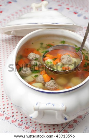 Vegetable soup with meatballs in a tureen
