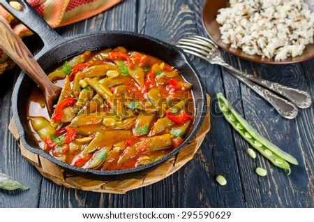 Vegetable stew with beans, paprika and spices in tomato sauce