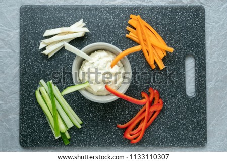 Vegetable sticks and dips in bowl. Healthy vegetables and dip snack. #1133110307