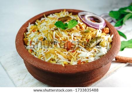 Vegetable / veg biryani with mixed veggies served with raita Stock fotó ©