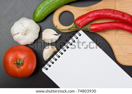 vegetables and cooking utensils for cutting table