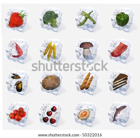 Vegetables and food frozen in ice cubes isolated on white background