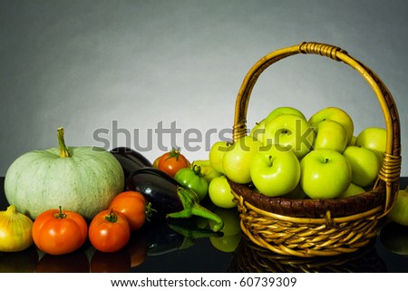 Vegetables and fruit on the dark background (design sketch autumn)