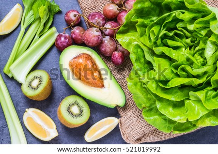 Vegetables and fruits detox ingredients for green smoothie top view.