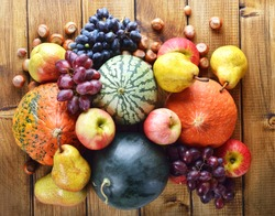 Vegetables and fruits on a wooden background