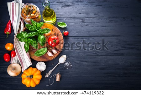 Vegetables and spices ingredient for cooking italian food on black wooden old board in rustic style #474119332