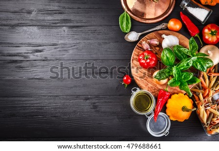 Vegetables and spices ingredient for cooking italian food on black wooden old board in rustic style #479688661