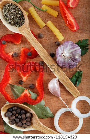 Vegetables and spices on wooden table.