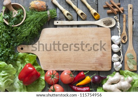 Vegetables and spices vintage border and empty cutting board