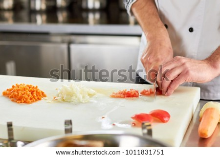 Vegetables chopping, piles of chopped vegetables. Red bell pepper chopping, chopped bell pepper. Vegetables dicing.