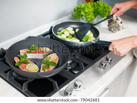 vegetables dish prepared in a black skillet in the kitchen